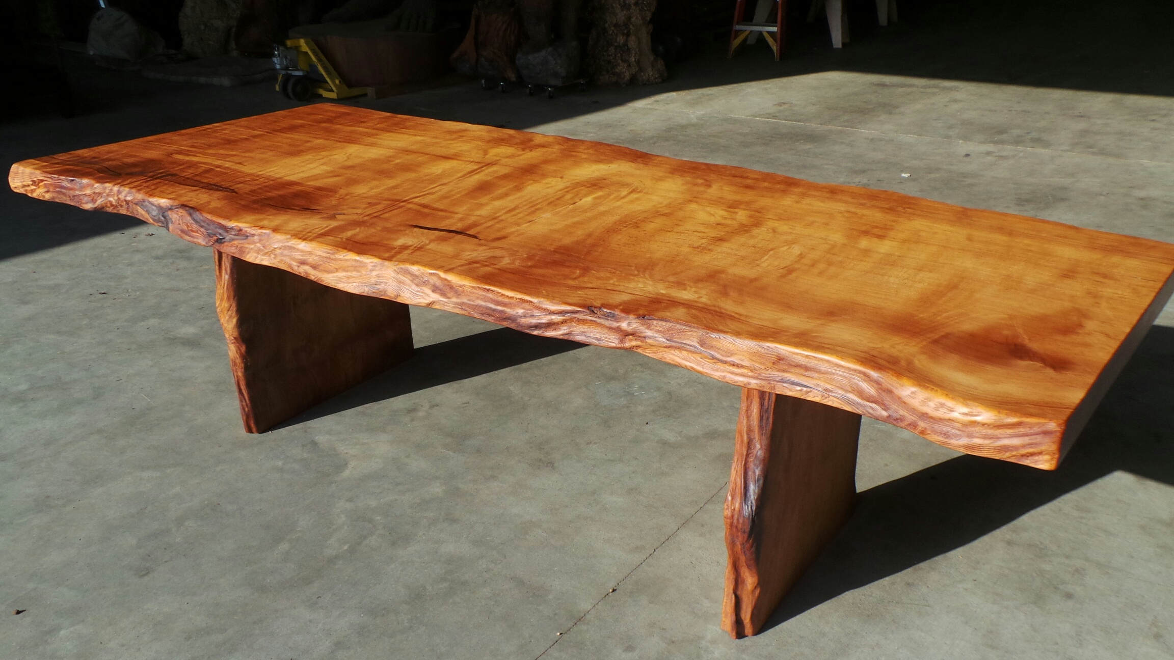 just one example of how we can shape and finish a raw old growth redwood slab like the slabs below rustic dining tables and conference tables