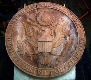 This is a redwood burl crest located at the US District Court in San Francisco, CA.